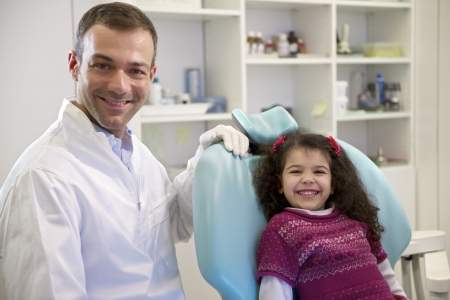 Portrait-of-child-and-dentist-in-dental-studio-e1446038397964 Making a Trip to the Dentist Less Frightening for Kids
