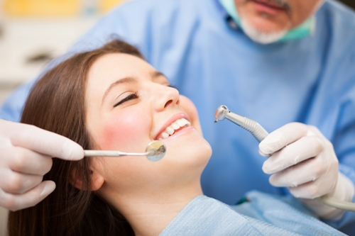 Dentist-doing-a-treatment The important differences between cosmetic and aesthetic dentistry