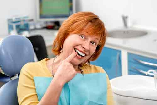 Dental-Implants-vs-Dentures Facts about the Dangers of Missing Teeth