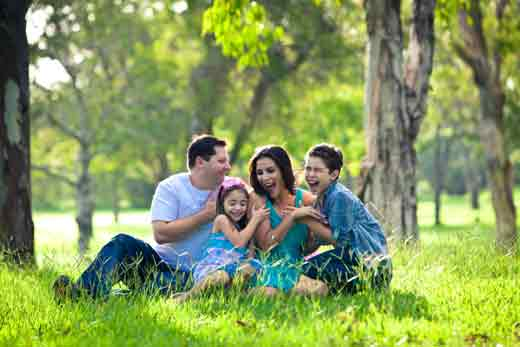 Family-laughing-during-picnic Great Teeth Boost Personal Confidence
