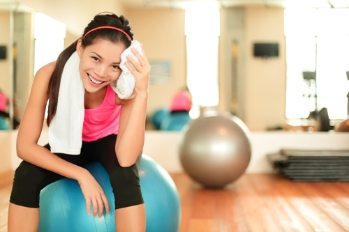 Woman-in-gym-resting-on-pilates-Exercise Chronic Migraines: Pain Remedies and Treatment